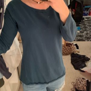 blue/green sweater with open knit sheer back